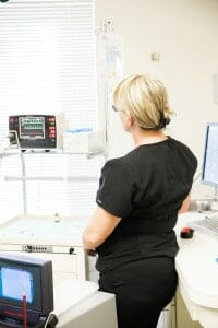 dental assistant monitoring vitals