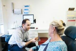 Dentist with model of teeth