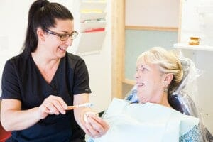 hygienist demonstrating brushing